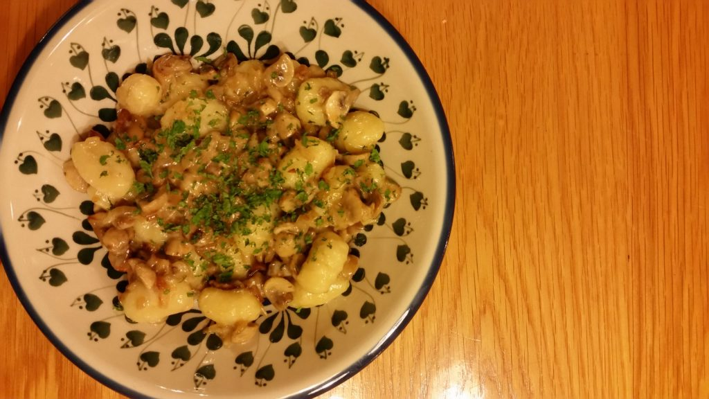 Shows Potato gnocchi with mushrooms and cheese